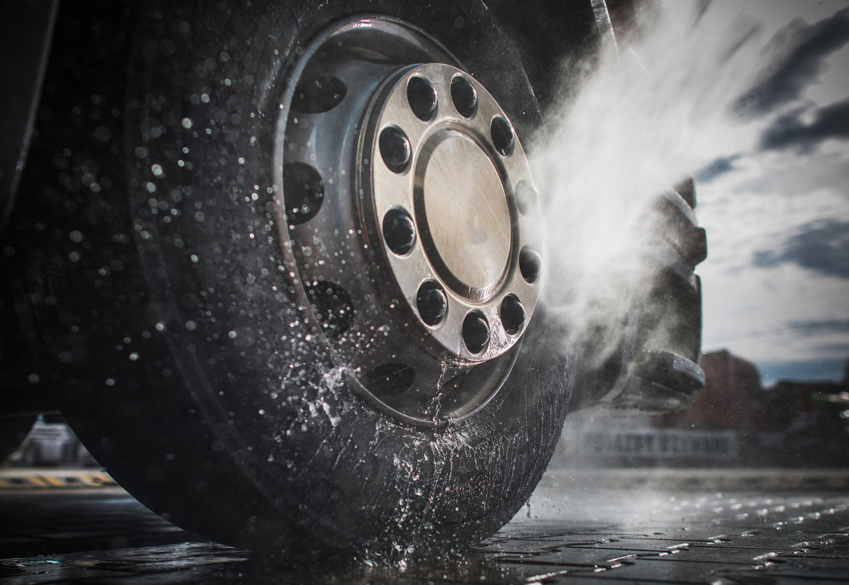truck wheel being washed